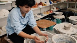 Student works with clay at Manhattan Day School.