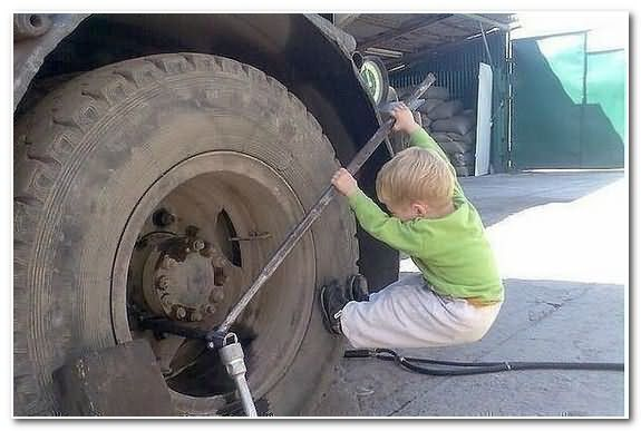 Baby Playing On Tire