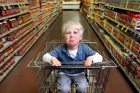 Child in a shopping cart